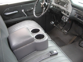 Graphite Shortie console. Works great in vehicles with a stick shift.